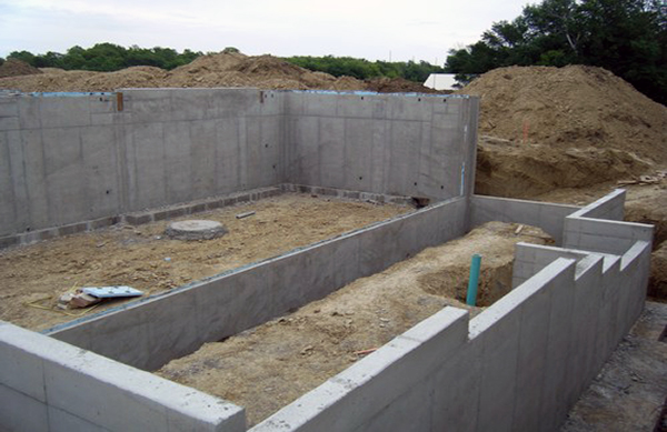 Macleod construction inc caissons canopy concrete for Poured concrete foundation walls